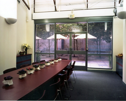 Light and airy conference room lit by indirect lighting for community gatherings