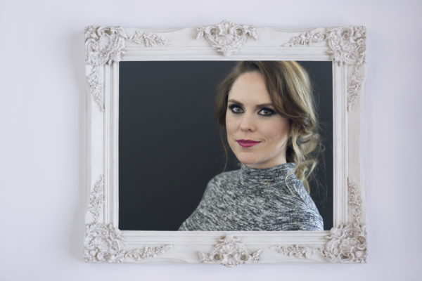 Ornate vintage white picture frame with portrait