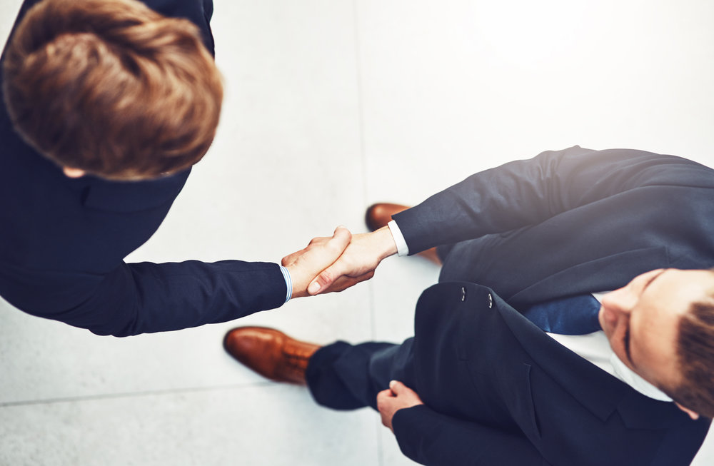 Business men shaking hands after a deal