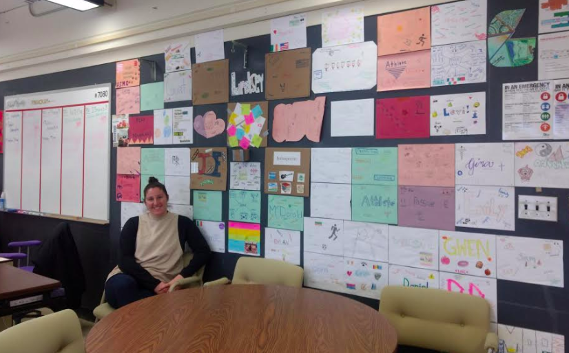 Ms. MacKay surrounded by her students' Identity Projects