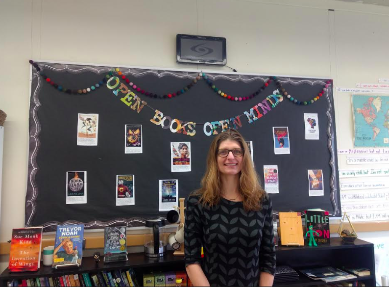 Ms. Smetana showcasing the independent reading texts her students have chosen this year.
