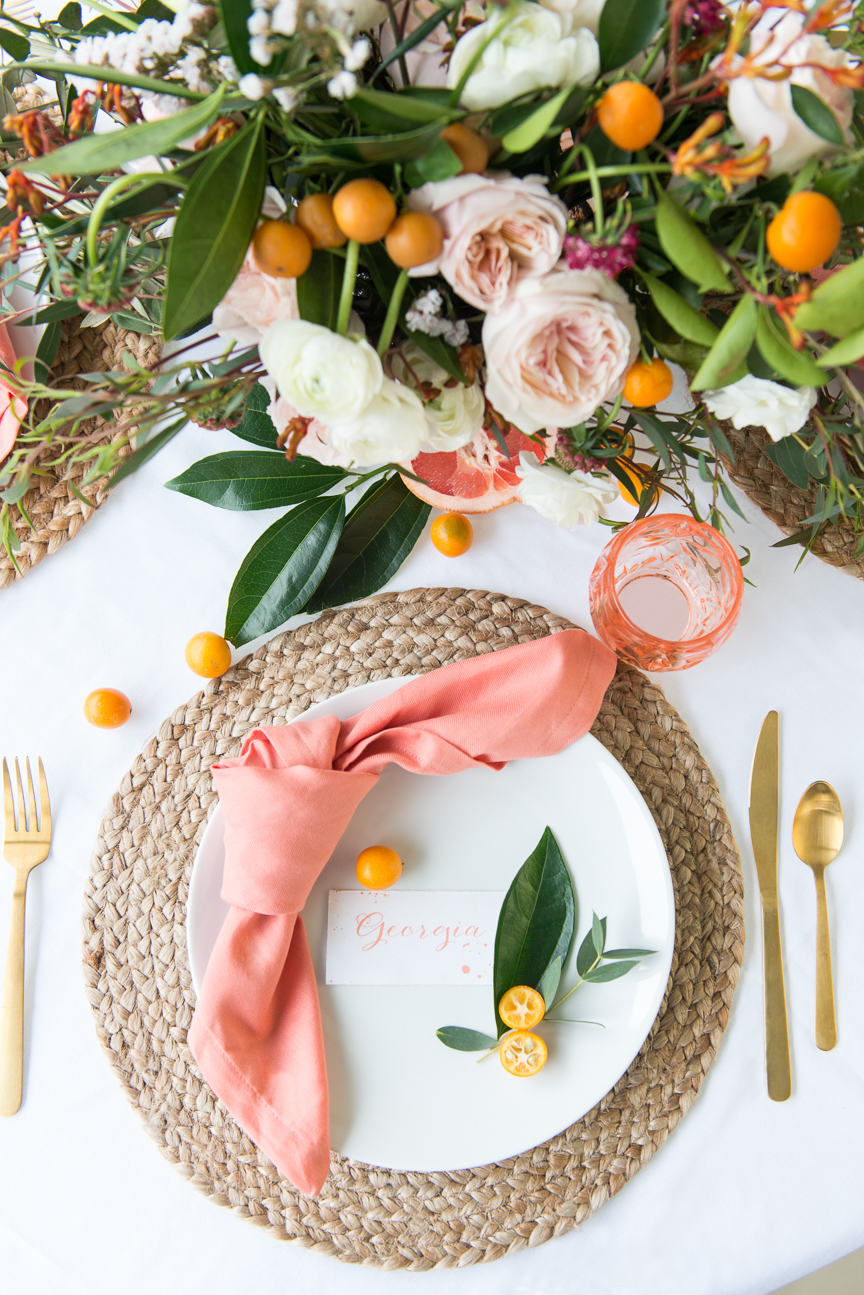 Brunch in Bloom | Floral and Citrus Brunch | Floral Place Setting | Spring Place Setting | Spring Brunch Ideas | Kumquats | Grapefruit | Citrus Table | Citrus Tablescape | Prop Styling Ideas | Food Styling Ideas | Food and Prop Styling Ideas | Spring Party | Colorful Spring Tablescape | Spring Tablescape for Round Tables | White Dishes | Orange | Pink | Paprika Southern