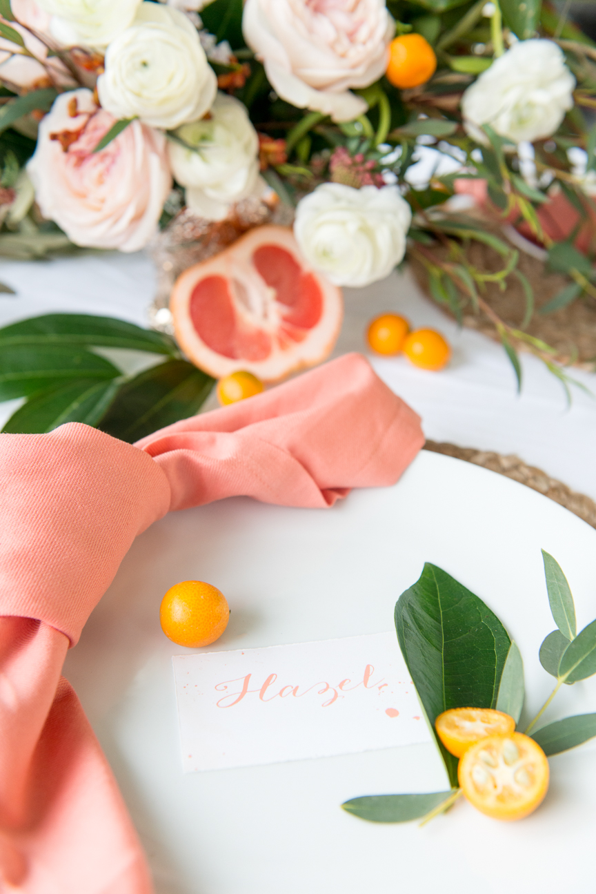 Brunch in Bloom | Floral and Citrus Brunch | Floral Place Setting | Spring Place Setting | Spring Brunch Ideas | Kumquats | Grapefruit | Citrus Table | Citrus Tablescape | Prop Styling Ideas | Food Styling Ideas | Food and Prop Styling Ideas | Spring Party | Colorful Spring Tablescape | Champagne Bar | Mimosa Bar | Spring Tablescape for Round Tables | White Dishes | Orange | Pink | Paprika Southern