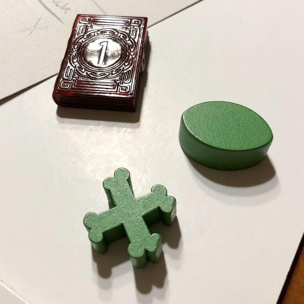 Tokens from Vast: The Crystal Caverns, and a d2 from PolyHero's Wizard Dice, which I'm currently using to test the game