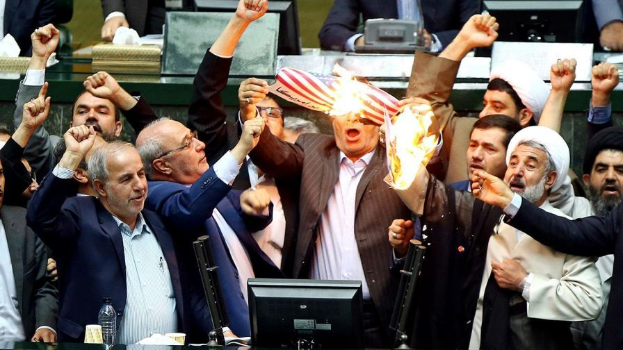 Photo via  GovBundle : Iranian Law Makers Burning the US Flag, after Trump withdraws from deal.