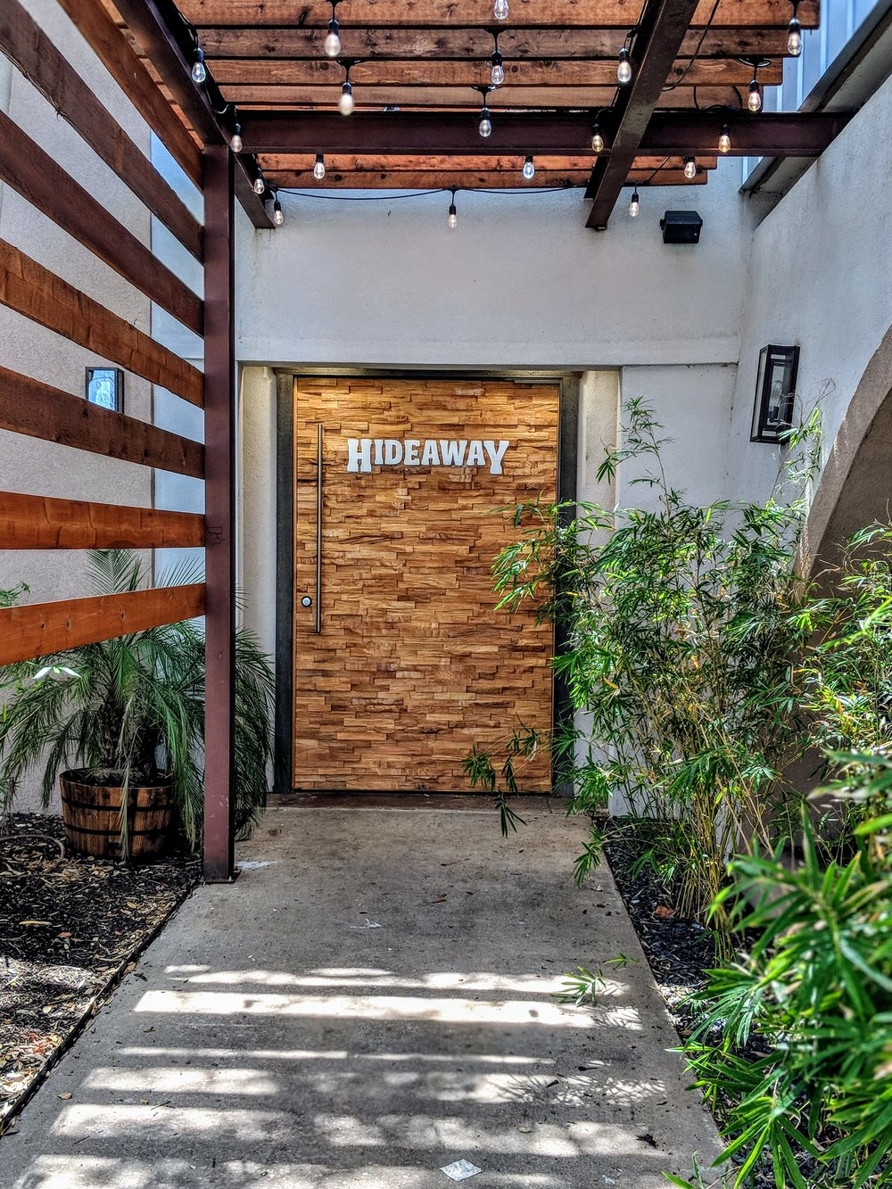 The tucked away entrance of Hideaway Kitchen & Bar