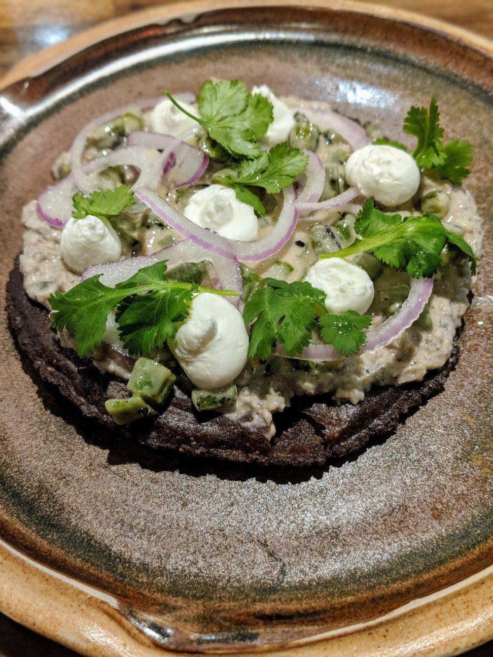 Tostada, field pea hummus, marinated green beans