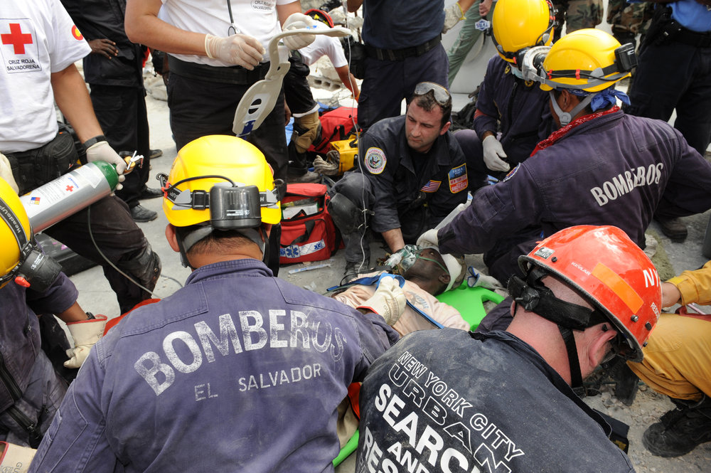 Multi-national rescue teams, including New York's Urban Search and Rescue Taskforce1, extricate people trapped in earthquake ravaged Haiti, January 14, 2010. Photo by Todd Maisel, New York Daily News