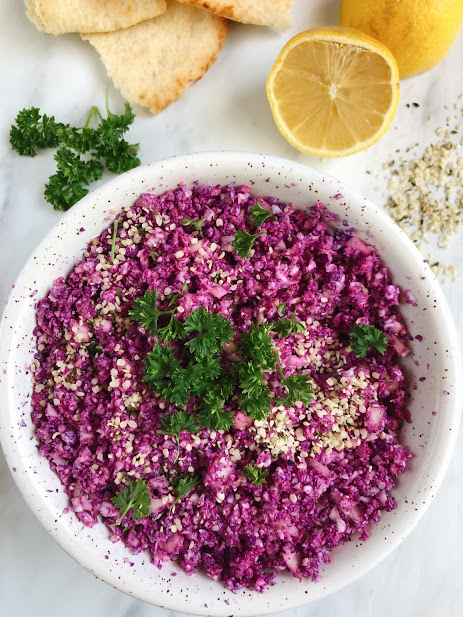 Purple cauliflower Tabouleh - 1 head of purple cauliflower (any kind works)1/4 cup white onion1/4 cup hemp seeds (I use Manitoba Harvest Hemp Hearts)1 tsp salt1 tsp pepper2 tbsp olive oil1 tbsp lemon juice1 cup of chopped parsleyMETHODCut cauliflower into small forests, and blend in a food processor until you make some cauliflower rice.Chop up the the onion, and parsley, mix into a bowl with the chopped cauliflower, and add in the hemp seeds.In a separate bowl, add the wet ingredients to create the vinaigrette.Mix in the wet ingredients with the cauliflower mixture. Store in the fridge, and serve on hummus or as a side dish.