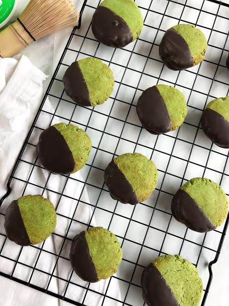 Chocolate Dipped Matcha Cookies - Ingredients:3 cups almond flour1 tsp baking soda¼ tbsp baking powder1 tbsp cinnamon3 scoops Vital Proteins Matcha Collagen1 tsp vanilla extract½ cup almond milk¼ cup maple syrup¼ cup coconut oil, melted1 egg1 cup dark chocolate, meltedDirections:Preheat oven to 350° F. In a large mixing bowl add all dry ingredients (except dark chocolate) and mix together. In a separate bowl, add in the wet ingredients and whisk until well combined.Combine both wet and dry ingredients and mix together with a wooden spoon.Once mix is ready, prepare a baking sheet lined with parchment paper. Roll mix into balls (1 tablespoon worth) and press down to make them flat.Bake for 10-12 minutes and let cool on a cooling wrack. While the cookies are cooling, place the dark chocolate and 1 tsp. of coconut oil in a sauce pan on low heat until melted.Dip half of the cookie into dark chocolate mix and place back on the baking sheet. Let cookies cool in the fridge to harden the chocolate for about 20 minutes.Take out of the fridge, and enjoy!