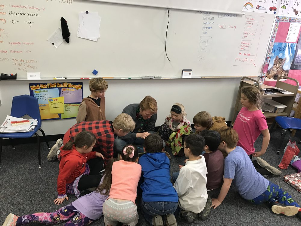 Hunter sharing seashells, rocks, and other trinkets from the east coast with his 2nd + 3rd grade class.