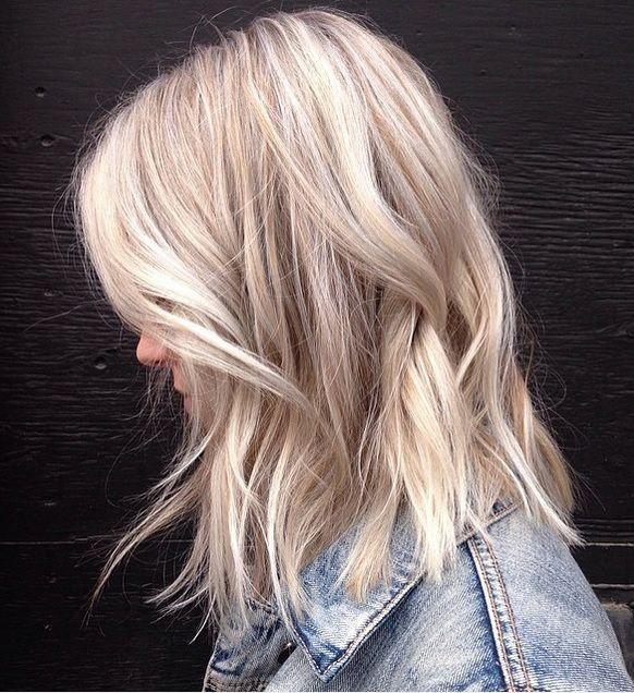 Dimensional dusty blonde hair.