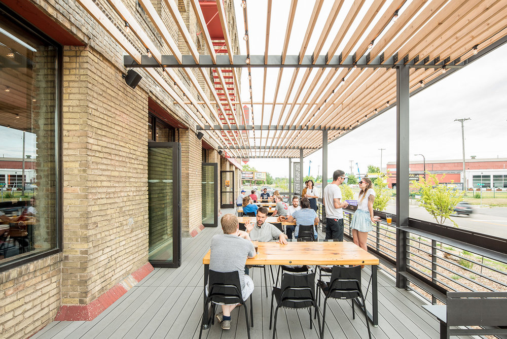 Custom steel and wood pergola on Headflyer Brewing patio by Christian Dean Architecture.