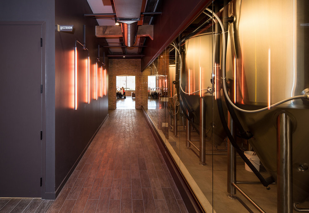 Custom neon lights in remodeled brewery space of Headflyer Brewing by Christian Dean Architecture.