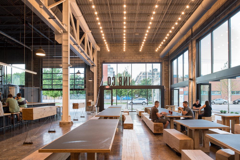 Custom wood tables and benches in modern brewery in Minneapolis by Christian Dean Architecture.