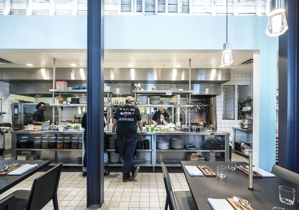 open kitchen design with dining tables at upton 43 restaurant in minneapolis