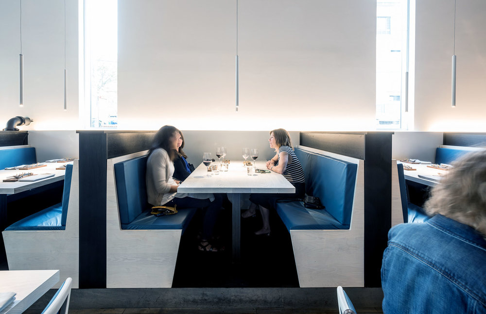 custom wood dining booths with blue leather seats