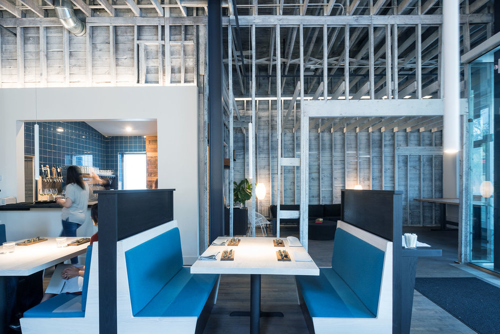 custom modern booths in scandinavian restaurant remodel by christian dean architecture