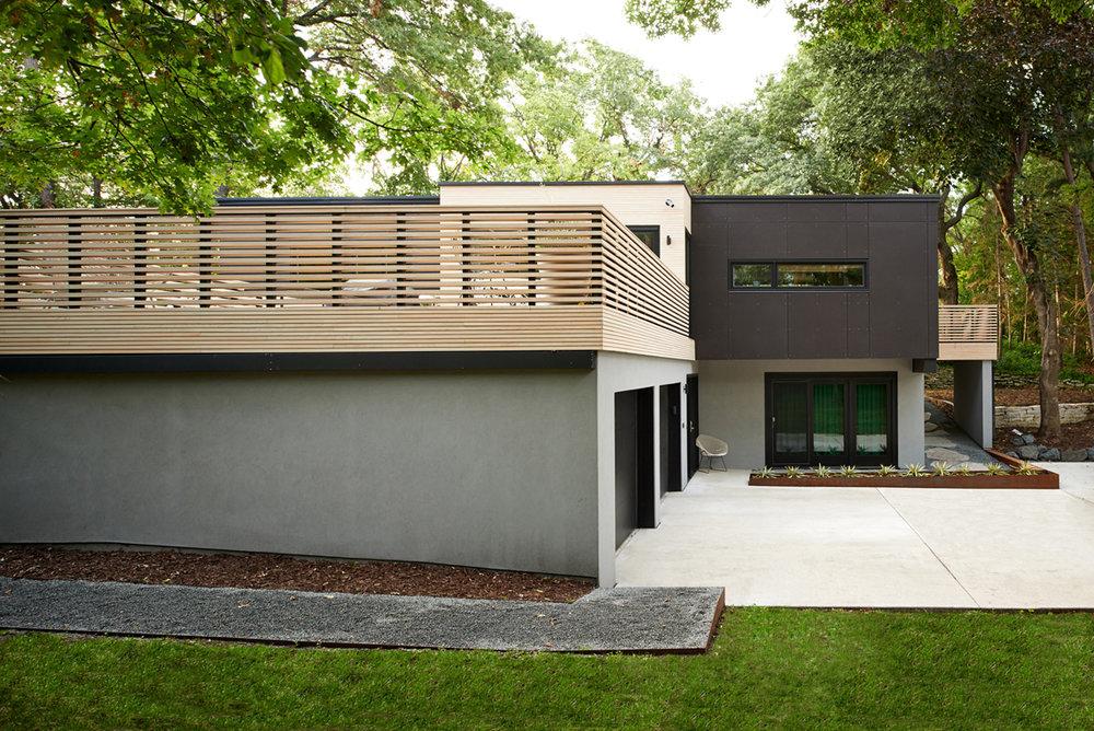 Roof deck with custom wood railing on modern home