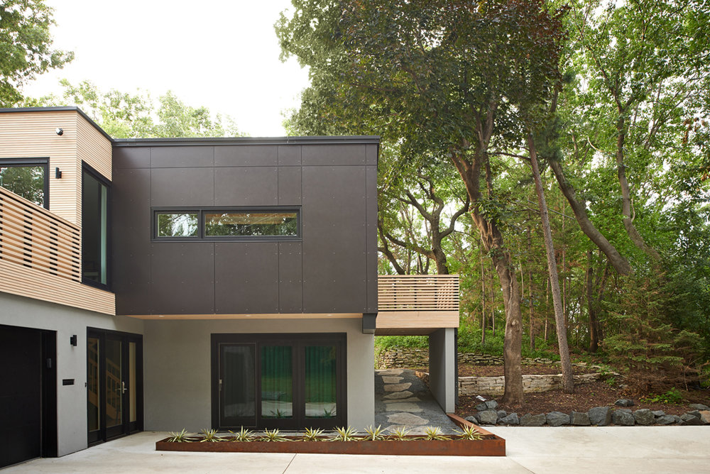 Modern remodel with corten steel, stucco, and wood exterior