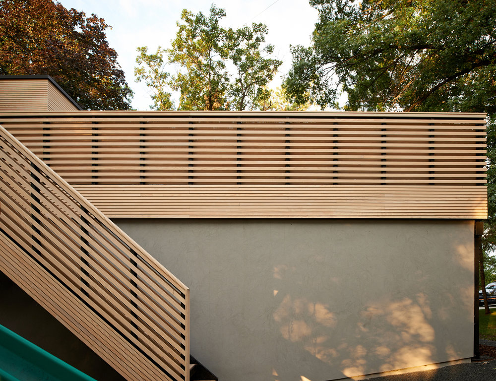 Custom wooden stair and railing on roof deck