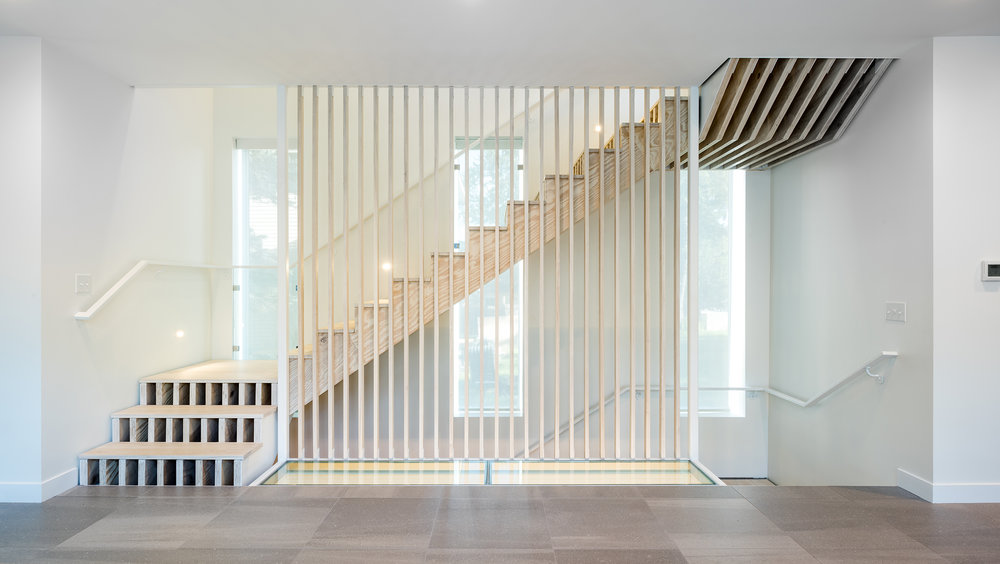 Custom accoya staircase with exposed stringer and glass floor detail