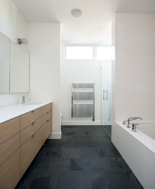 Minimal monochromatic master bathroom designed by Christian Dean Architecture