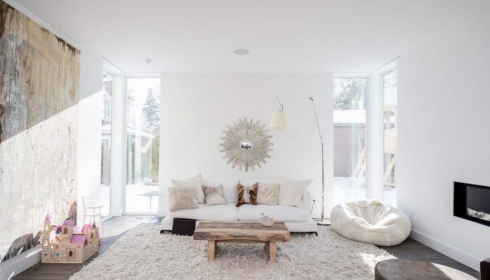Modern light-filled living room with casual furniture