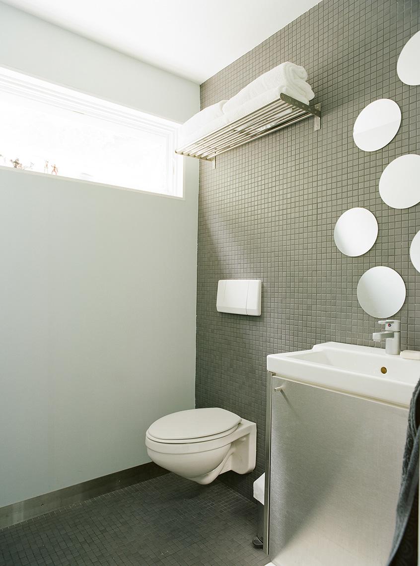 Modern european bathroom renovation with grey tile