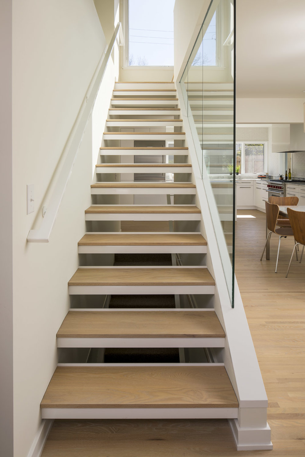 Custom open wood stair tread detail in modern home