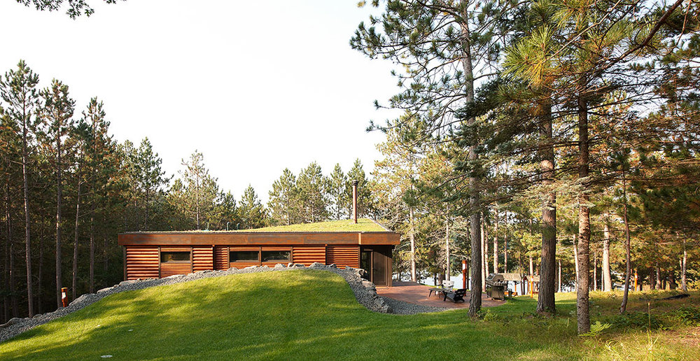 Hidden modern cabin with green roof designed by Christian Dean Architecture