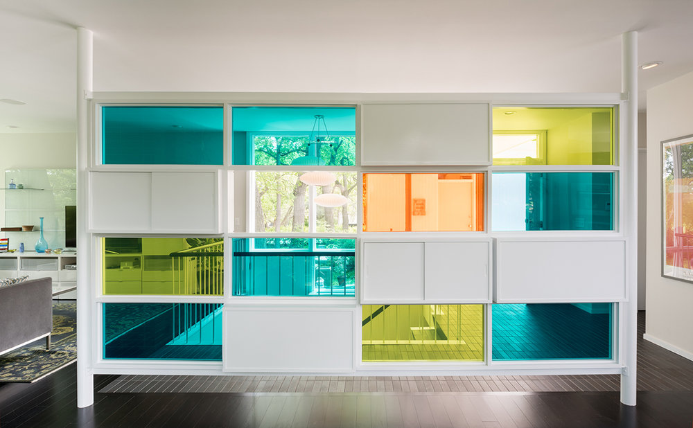 Colorful divider wall in a mid-century home entry