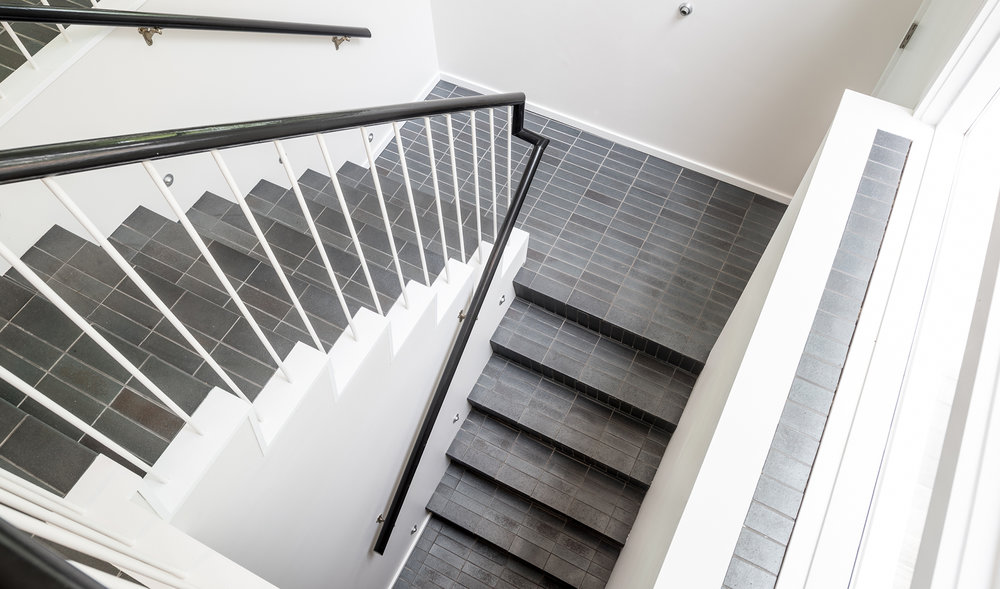 Tiled open stairwell designed by Christian Dean Architecture