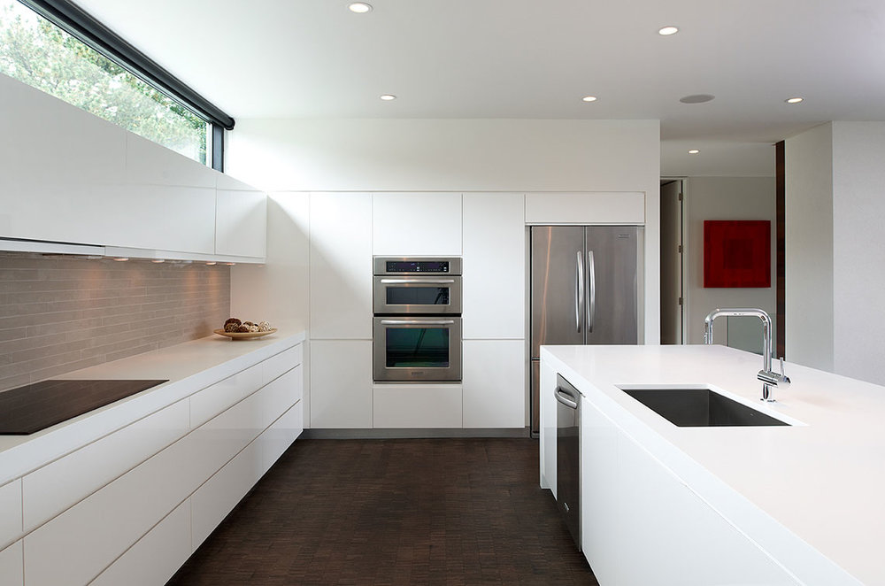 Minimal white kitchen with clerestory windows