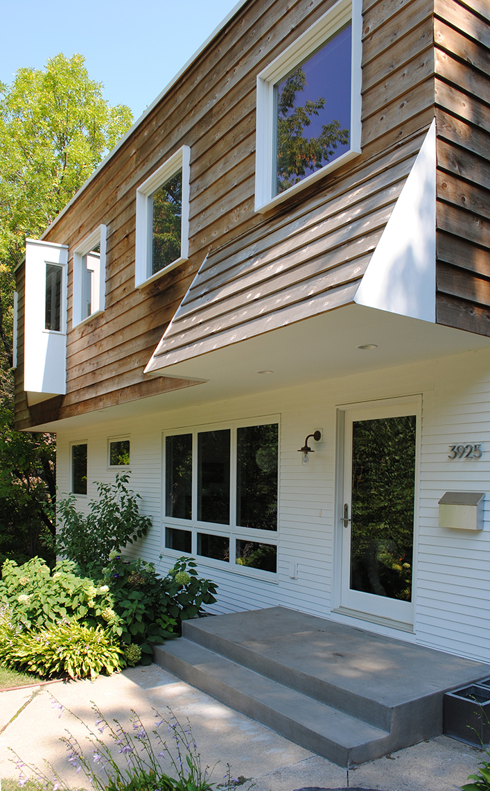 Geometric entry canopy over front porch