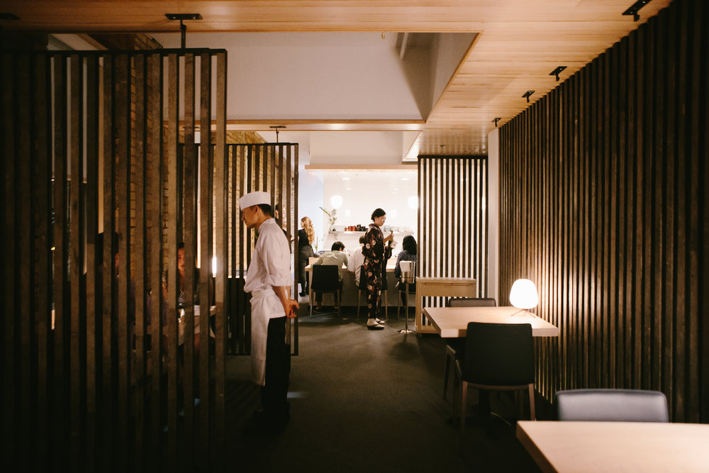 modern japanese restaurant with wood slat dividers and custom wood ceiling details