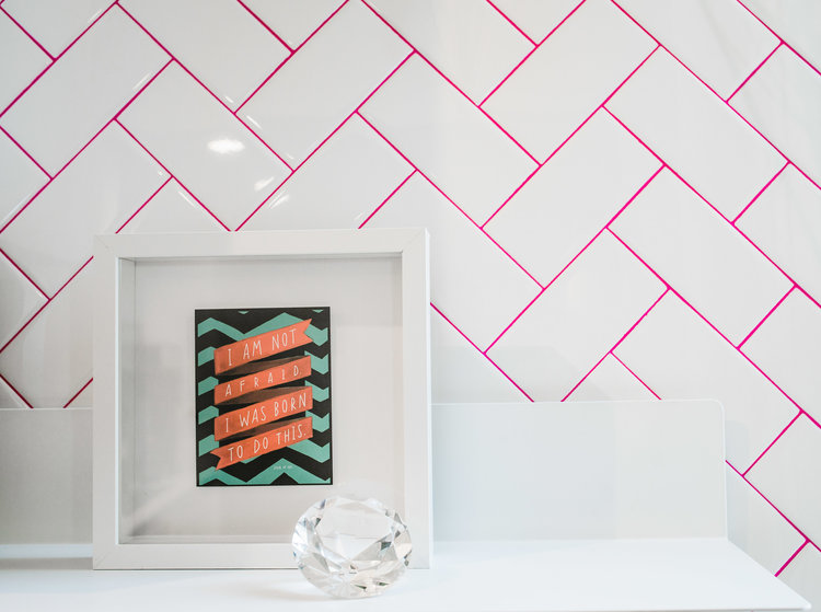 modern kitchen remodel with white herringbone tile layout and pink grout backsplash