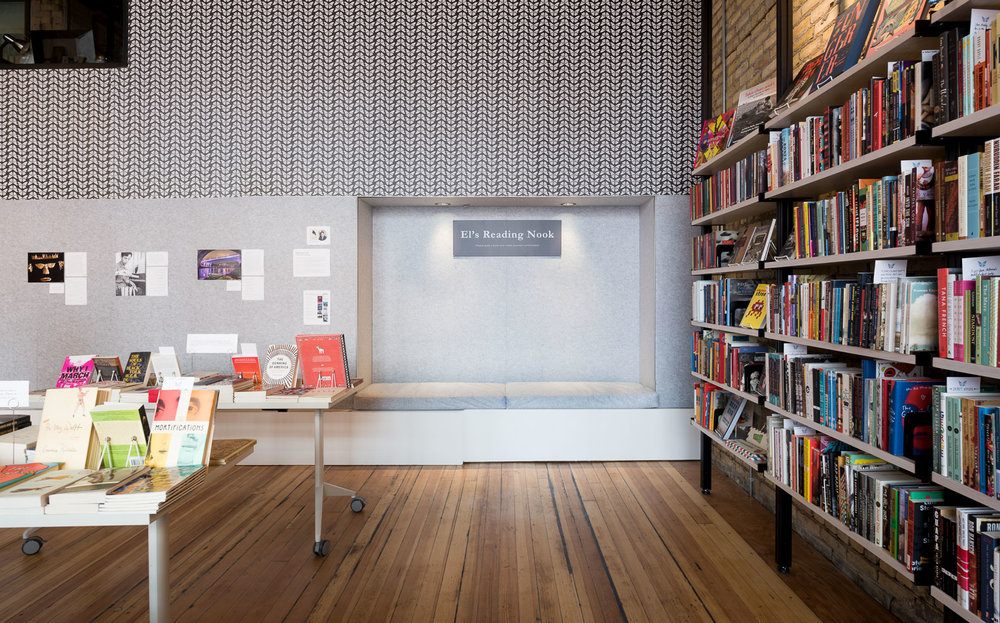built-in felt reading nook in modern minneapolis bookstore by christian dean architecture