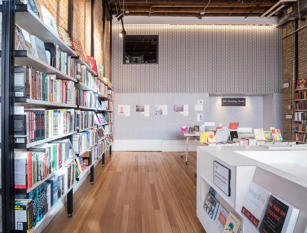 custom open bookshelves and custom white desk in modern bookstore remodel