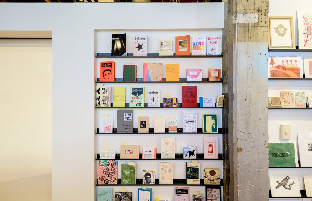 Custom modern black metal display shelves in Minneapolis gift shop by Christian Dean Architecture.
