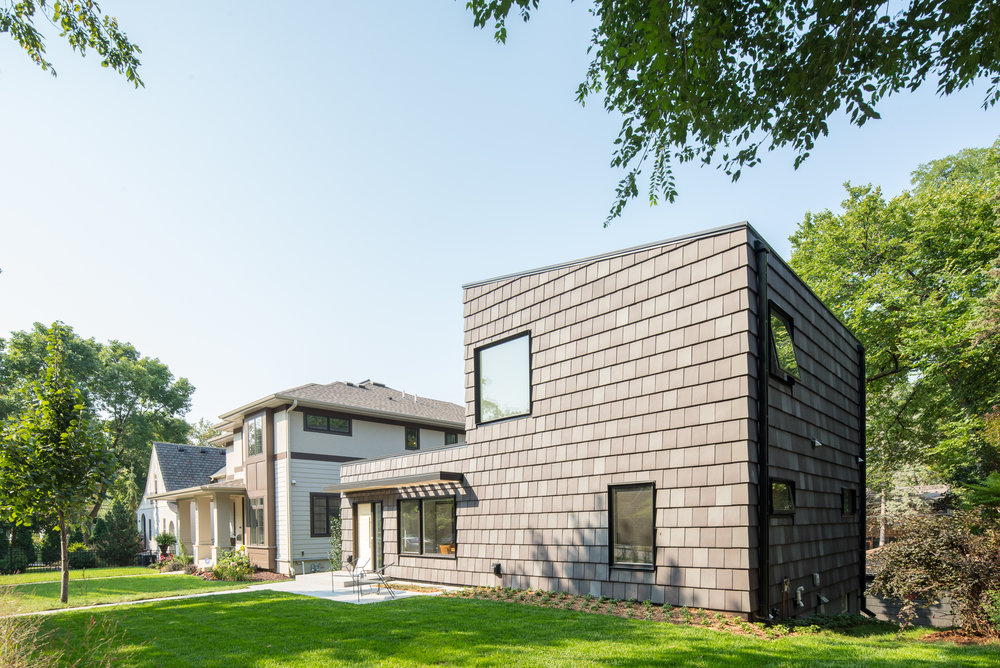 Black clay tile clad modern rambler renovation in Minneapolis by Christian Dean Architecture