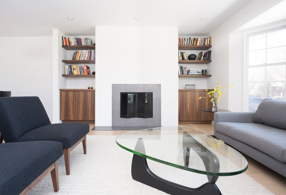 Modern living room fireplace with custom built-in cabinetry