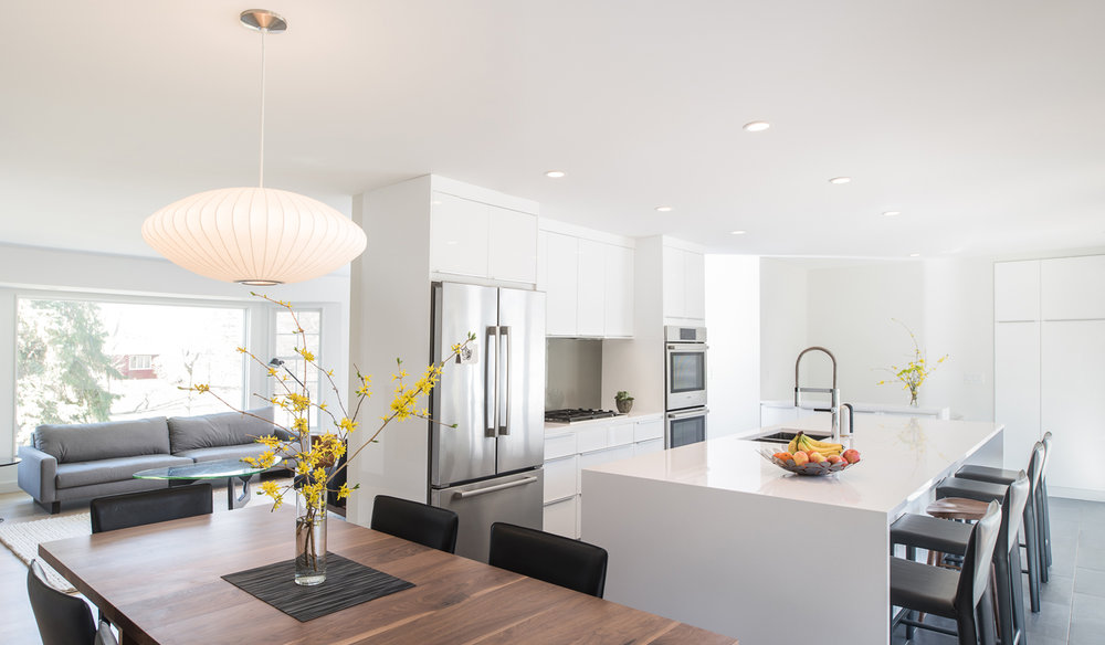 Modern dining area within bright white kitchen