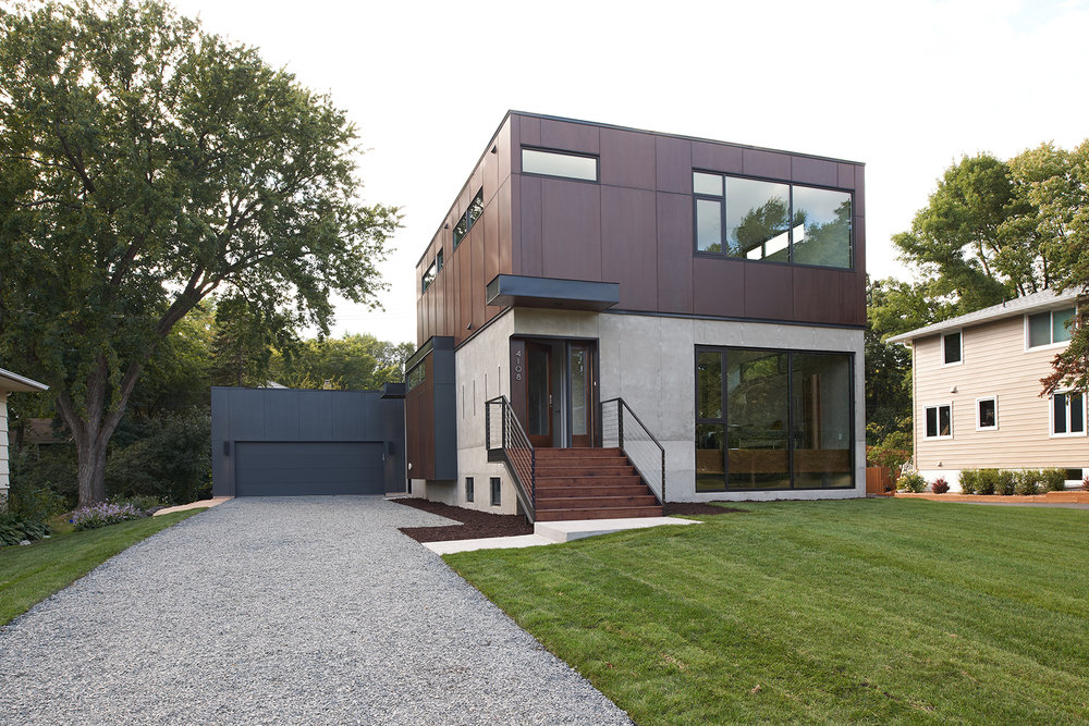 Modern home with concrete and corten steel exterior in Minneapolis by Christian Dean Architecture