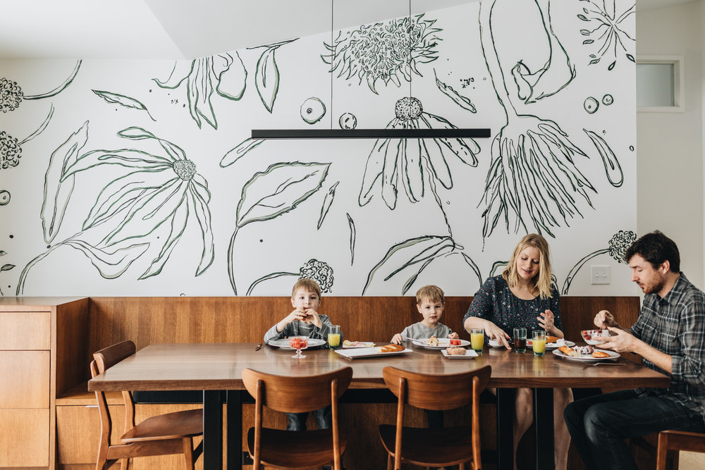 St. Louis Park remodel project with custom wood bench seating and wall mural by She She