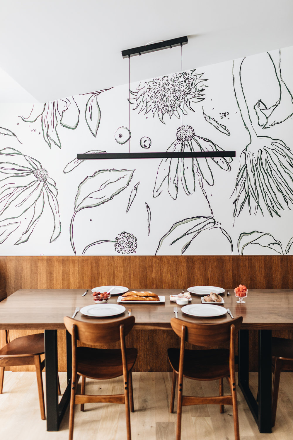 Custom floral wall mural by She She in dining space of St. Louis Park remodel by Christian Dean Architecture.