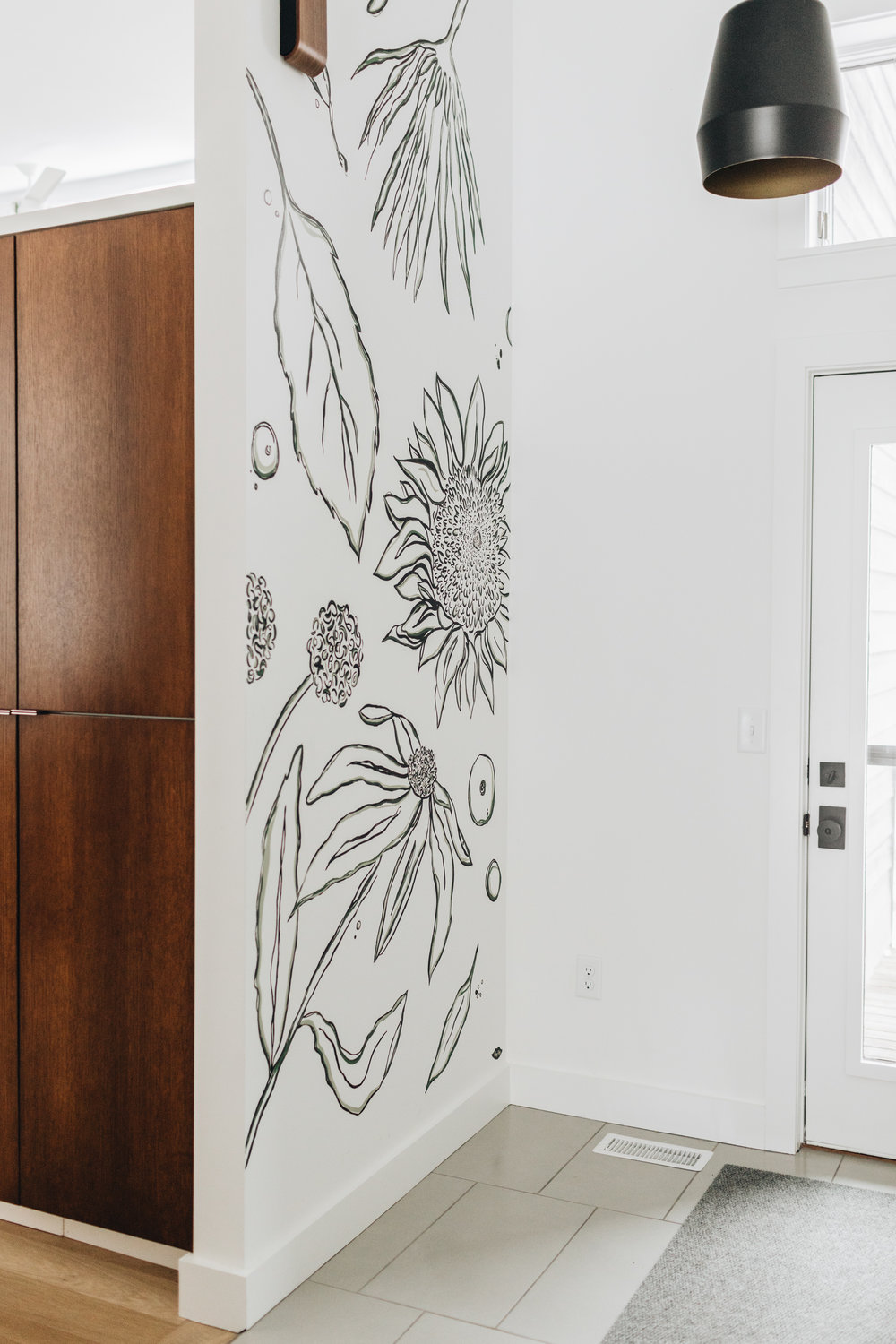 Custom wall mural in entryway of St. Louis Park remodel by Christian Dean Architecture.