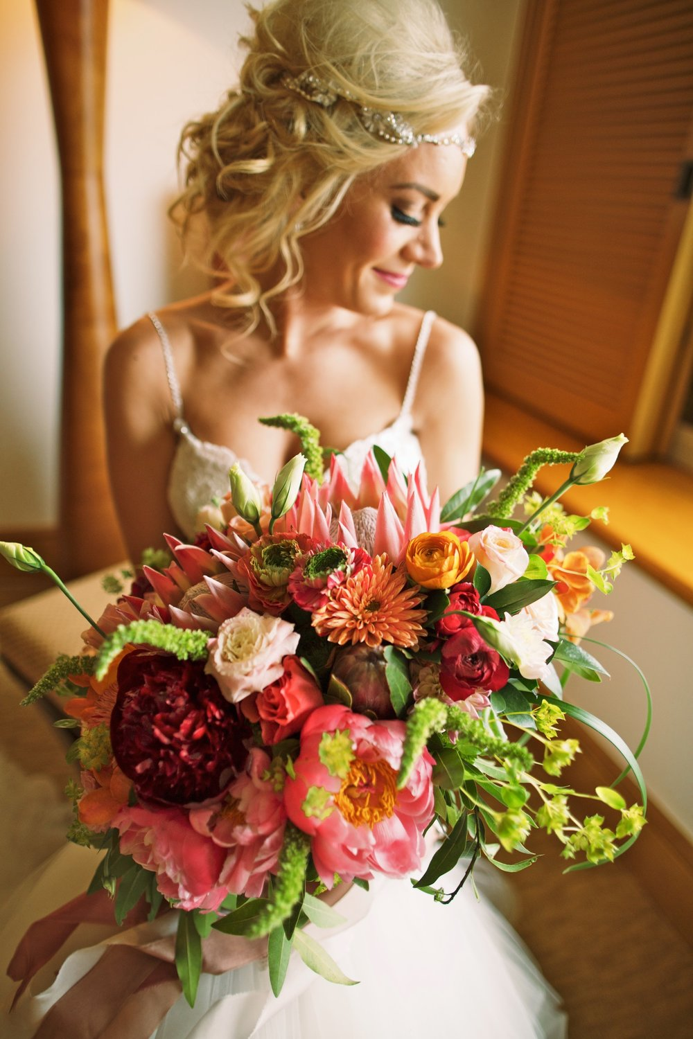 Bride with tropical bouquet.jpg