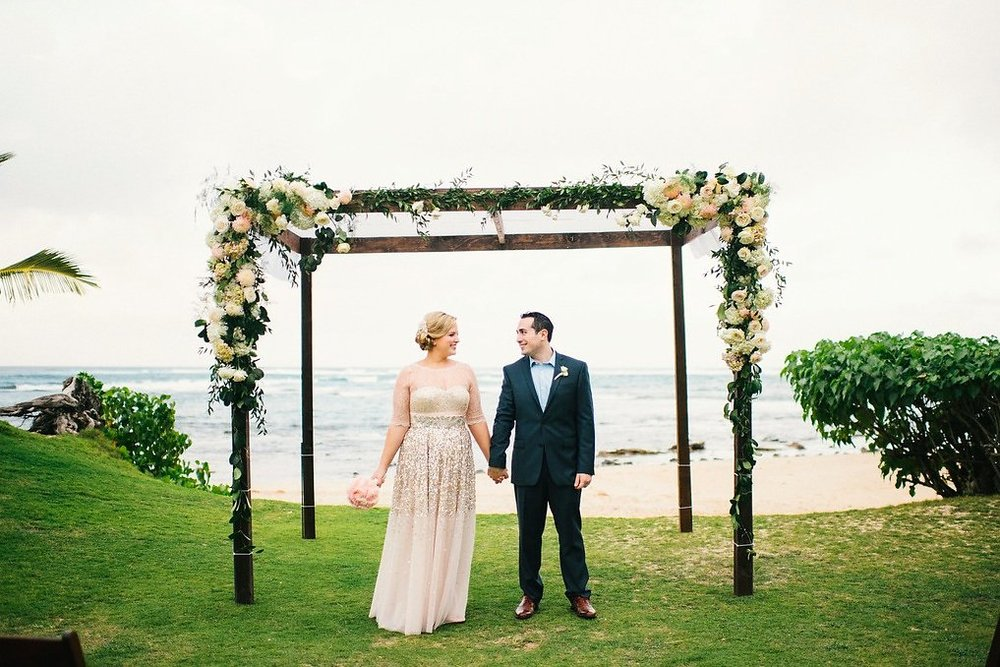 bride and groom with arch.jpg