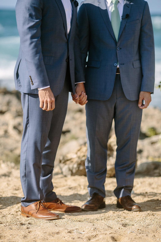 grooms holding hand.jpg